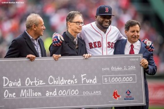 BOSTON, MA - OCTOBER 2: The Boston Red Sox present a check for a donation of one million dollars to the David Ortiz Children's Fund during an honorary retirement ceremony for David Ortiz #34 of the Boston Red Sox in his final regular season game at Fenway Park against the Toronto Blue Jays on October 2, 2016 at Fenway Park in Boston, Massachusetts. (Photo by Billie Weiss/Boston Red Sox/Getty Images) *** Local Caption *** David Ortiz