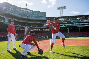 BOSTON, MA - OCTOBER 4: Jackie Bradley Jr. #25 and Chris Young #30 of the Boston Red Sox share a laugh during a workout before game one of the American League Division Series against the Cleveland Indians on October 4, 2016 at Fenway Park in Boston, Massachusetts. (Photo by Billie Weiss/Boston Red Sox/Getty Images) *** Local Caption *** Jackie Bradley Jr.; Chris Young