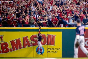 CLEVELAND, OH - OCTOBER 6: Mookie Betts #50 of the Boston Red Sox attempts to catch a home run ball during the third inning of game one of the American League Division Series against the Cleveland Indians on October 6, 2016 at Progressive Field in Cleveland, Ohio. (Photo by Billie Weiss/Boston Red Sox/Getty Images) *** Local Caption *** Mookie Betts
