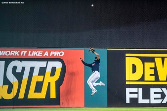 CLEVELAND, OH - OCTOBER 6: Jackie Bradley Jr. #25 of the Boston Red Sox leaps as he catches a fly ball during the third inning of game one of the American League Division Series against the Cleveland Indians on October 6, 2016 at Progressive Field in Cleveland, Ohio. (Photo by Billie Weiss/Boston Red Sox/Getty Images) *** Local Caption *** Jackie Bradley Jr.