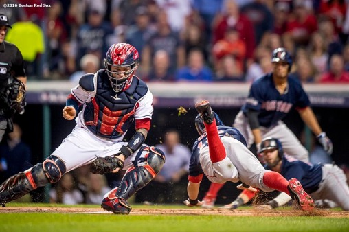 CLEVELAND, OH - OCTOBER 6: Brock Holt #12 of the Boston Red Sox is tagged out by Roberto Perez #55 of the Cleveland Indians during the first inning of game one of the American League Division Series on October 6, 2016 at Progressive Field in Cleveland, Ohio. (Photo by Billie Weiss/Boston Red Sox/Getty Images) *** Local Caption *** Brock Holt; Roberto Perez