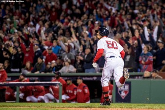 BOSTON, MA - OCTOBER 10: Mookie Betts #50 of the Boston Red Sox rounds first base after hitting a double during the sixth inning of game three of the American League Division Series against the Cleveland Indians on October 10, 2016 at Fenway Park in Boston, Massachusetts. (Photo by Billie Weiss/Boston Red Sox/Getty Images) *** Local Caption *** Mookie Betts