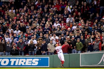 BOSTON, MA - OCTOBER 10: Mookie Betts #50 of the Boston Red Sox catches a fly ball during the eighth inning of game three of the American League Division Series against the Cleveland Indians on October 10, 2016 at Fenway Park in Boston, Massachusetts. (Photo by Billie Weiss/Boston Red Sox/Getty Images) *** Local Caption *** Mookie Betts