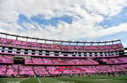 FOXBORO, MA - OCTOBER 16: Fans participate in a card stunt for breast cancer awareness following the first quarter of a game between the New England Patriots and the Cincinnati Bengals at Gillette Stadium on October 16, 2016 in Foxboro, Massachusetts. (Photo by Billie Weiss/Getty Images)