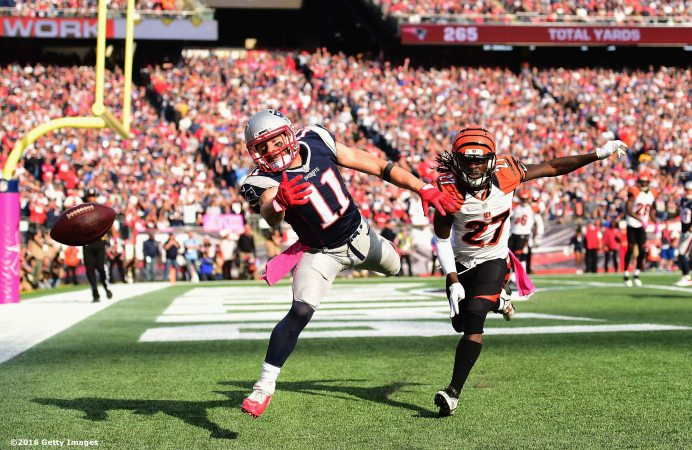 FOXBORO, MA - OCTOBER 16: Julian Edelman #11 of the New Engalnd Patriots attempts a catch against Dre Kirkpatrick #27 of the Cincinnati Bengals during a game at Gillette Stadium on October 16, 2016 in Foxboro, Massachusetts. (Photo by Billie Weiss/Getty Images) *** Local Caption *** Julian Edelman; Dre Kirkpatrick