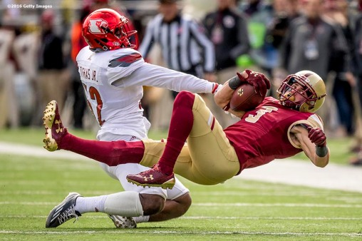 CHESTNUT HILL, MA - NOVEMBER 05: Stacy Thomas #32 of Louisville tackles Michael Walker #3 of Boston College during the second quarter of a game at Alumni Stadium on November 5, 2016 in Chestnut Hill, Massachusetts. (Photo by Billie Weiss/Getty Images) *** Local Caption *** Stacy Thomas; Michael Walker
