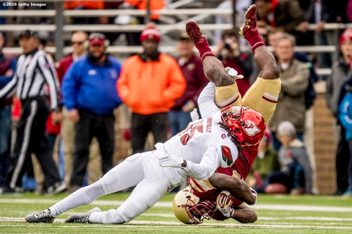 CHESTNUT HILL, MA - NOVEMBER 05: Sean McCormick #15 of Louisville tackles Davon Jones #16 of Boston College during the second quarter of a game at Alumni Stadium on November 5, 2016 in Chestnut Hill, Massachusetts. (Photo by Billie Weiss/Getty Images) *** Local Caption *** Sean McCormick; Davon Jones