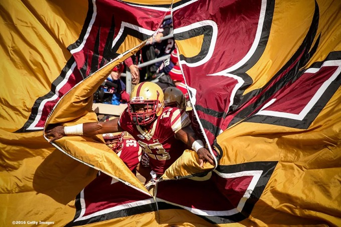 CHESTNUT HILL, MA - NOVEMBER 05: Myles Willis #23 of Boston College breaks through a flag as the team is introduced before a game against Louisville at Alumni Stadium on November 5, 2016 in Chestnut Hill, Massachusetts. (Photo by Billie Weiss/Getty Images) *** Local Caption *** Myles Willis