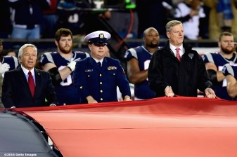 FOXBORO, MA - NOVEMBER 13: New England Patriots owner Robert kraft and Massachusetts Governor Charlie Baker hold the American Flag before a game against the Seattle Seahawks at Gillette Stadium on November 13, 2016 in Foxboro, Massachusetts. (Photo by Billie Weiss/Getty Images) *** Local Caption *** Charlie Baker;Robert Kraft