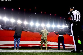 Members of the military hold an American Flag during the National Anthem before a game between the New England Patriots and the Seattle Seahawks at Gillette Stadium on November 13, 2016 in Foxboro, Massachusetts.