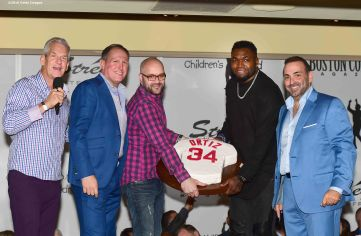 BOSTON, MA - NOVEMBER 07: David Ortiz of the Boston Red Sox is presented with a cake by Boston Common Magazine Publisher Glenn Kelley (left) and Nick Varano of Strega (right) during a Boston Common Magazine event at Strega Waterfront on November 7, 2016 in Boston, Massachusetts. (Photo by Billie Weiss/Getty Images for Boston Common Magazine)