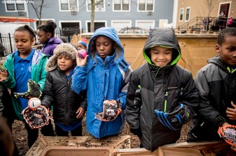 """Students play during recess with new Franklin youth baseball gloves donated by the Boston Red Sox at Codman Academy School as part of The Gift Of Sox and the Holiday Caravan in Dorchester, Massachusetts Thursday, December 8, 2016."""