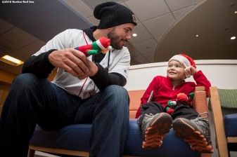 """Boston Red Sox pitcher Robby Scott greets a patient during a visit to The Jimmy Fund at Dana-Farber Cancer Institute as part of the 2016 Holiday Caravan in Boston, Massachusetts Friday, December 9, 2016."""