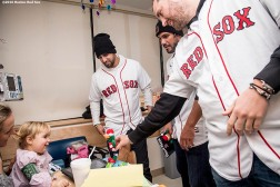 """Boston Red Sox infielder Deven Marrero and pitchers Robby Scott and Heath Hembree greet a patient during a visit to Boston Children's Hospital as part of the 2016 Holiday Caravan in Boston, Massachusetts Friday, December 9, 2016."""