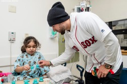 """Boston Red Sox infielder Deven Marrero greets a patient during a visit to Boston Children's Hospital as part of the 2016 Holiday Caravan in Boston, Massachusetts Friday, December 9, 2016."""