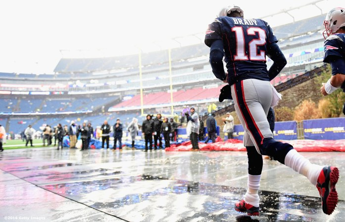 FOXBORO, MA - DECEMBER 24: Tom Brady #12 of the New England Patriots runs onto the field before a game against the New York Jets at Gillette Stadium on December 24, 2016 in Foxboro, Massachusetts. (Photo by Billie Weiss/Getty Images) *** Local Caption *** Tom Brady
