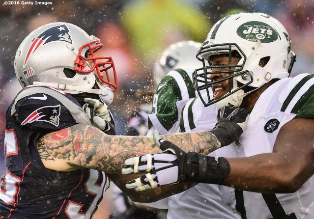 FOXBORO, MA - DECEMBER 24: Chris Long #95 of the New England Patriots blocks Ben Ijalana #71 of the New York Jets during the first quarter of a game at Gillette Stadium on December 24, 2016 in Foxboro, Massachusetts. (Photo by Billie Weiss/Getty Images) *** Local Caption *** Chris Long