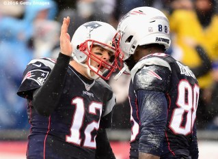 FOXBORO, MA - DECEMBER 24: Martellus Bennett #88 of the New England Patriots reacts with Tom Brady after catching a touchdown pass during the first quarter of a game against the New York Jets at Gillette Stadium on December 24, 2016 in Foxboro, Massachusetts. (Photo by Billie Weiss/Getty Images) *** Local Caption *** Tom Brady; Martellus Bennett