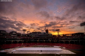 December 20, 2016, Boston, MA: The sun sets as the rink is installed in preparation for Frozen Fenway at Fenway Park in Boston, Massachusetts Tuesday, December 20, 2016. (Photo by Billie Weiss/Boston Red Sox)