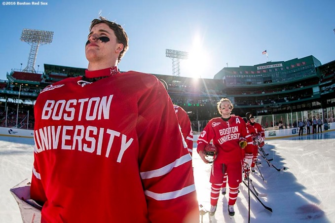 BOSTON, MA - JANUARY 08: Members of Boston University line up during the National Anthem before a Frozen Fenway game against the University of Massachusetts at Fenway Park on January 8, 2017 in Boston, Massachusetts. (Photo by Billie Weiss/Boston Red Sox/Getty Images)