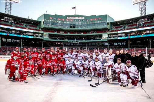 BOSTON, MA - JANUARY 08: Members of Boston University and the University of Massachusetts pose for a photograph after a Frozen Fenway game at Fenway Park on January 8, 2017 in Boston, Massachusetts. (Photo by Billie Weiss/Boston Red Sox/Getty Images)