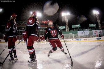 January 10, 2017, Boston, MA: Harvard University players are introduced before a game against Boston College during Capital One Frozen Fenway 2017 at Fenway Park in Boston, Massachusetts Tuesday, January 10, 2017. (Photo by Billie Weiss/Boston Red Sox)