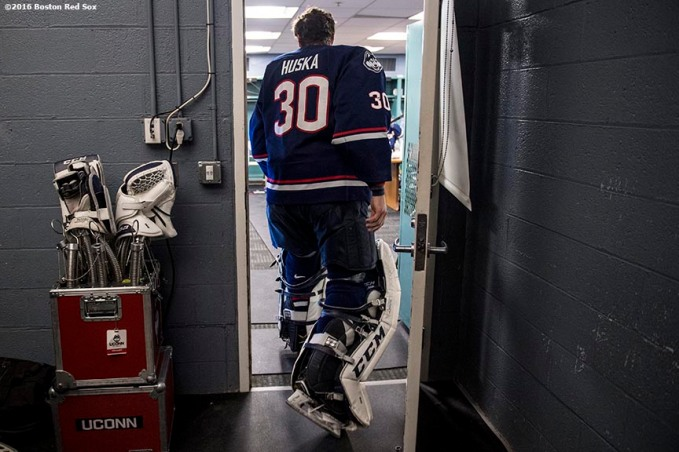 BOSTON, MA - JANUARY 14: Adam Huska #30 of the University of Connecticut walks into the locker room before a Frozen Fenway game against the University of Maine at Fenway Park on January 14, 2017 in Boston, Massachusetts. (Photo by Billie Weiss/Boston Red Sox/Getty Images) *** Local Caption *** Adam Huska