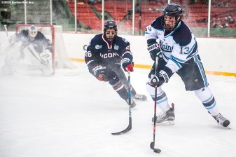 BOSTON, MA - JANUARY 14: Nolan Vesey #13 of the University of Connecticut handles the puck during a Frozen Fenway game against the University of Connecticut at Fenway Park on January 14, 2017 in Boston, Massachusetts. (Photo by Billie Weiss/Boston Red Sox/Getty Images) *** Local Caption *** Nolan Vesey