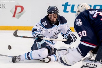 BOSTON, MA - JANUARY 14: Brendan Robins #22 of the University of Connecticut handles the puck during a Frozen Fenway game against the University of Connecticut at Fenway Park on January 14, 2017 in Boston, Massachusetts. (Photo by Billie Weiss/Boston Red Sox/Getty Images) *** Local Caption *** Brendan Robins