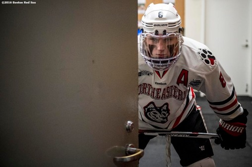 BOSTON, MA - JANUARY 14: Adam Gaudette #8 of Northeastern University waits in the locker room before a Frozen Fenway game against University of New Hampshire at Fenway Park on January 14, 2017 in Boston, Massachusetts. (Photo by Billie Weiss/Boston Red Sox/Getty Images) *** Local Caption *** Adam Gaudette