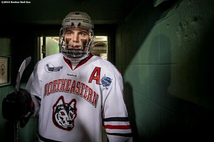 BOSTON, MA - JANUARY 14: Adam Gaudette #8 of Northeastern University exits the tunnel before a Frozen Fenway game against University of New Hampshire at Fenway Park on January 14, 2017 in Boston, Massachusetts. (Photo by Billie Weiss/Boston Red Sox/Getty Images) *** Local Caption *** Adam Gaudette
