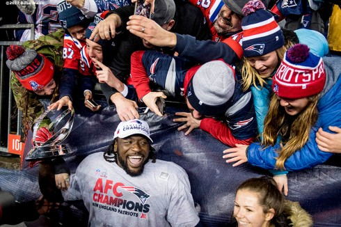 January 22, 2017, Foxboro, MA: New England Patriots runningback LeGarrette Blount celebrates with fans after defeating the Pittsburgh Steelers in the AFC Championship Game at Gillette Stadium in Foxboro, Massachusetts Sunday, January 22, 2017. (Photo by Billie Weiss)