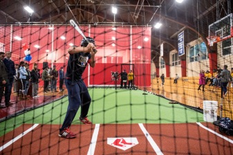 January 25, 2017, Boston, MA: A fan takes batting practice during the unveiling of a new indoor batting cage at the BCYFTobin Community Center in Roxbury Crossing, Massachusetts Wednesday, January 25, 2017. (Photos by Billie Weiss/Boston Red Sox)