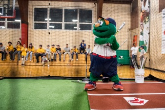January 25, 2017, Boston, MA: Boston Red Sox mascot Wally the Green Monster takes batting practice during the unveiling of a new indoor batting cage at the BCYFTobin Community Center in Roxbury Crossing, Massachusetts Wednesday, January 25, 2017. (Photos by Billie Weiss/Boston Red Sox)