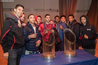 January 27, 2017, Boston, MA: Students pose for a photograph with the Boston Red Sox World Series trophies during a Jackie Robinson Day recognition event at Charlestown High School in Boston, Massachusetts Friday, January 27, 2017. (Photo by Billie Weiss/Boston Red Sox)