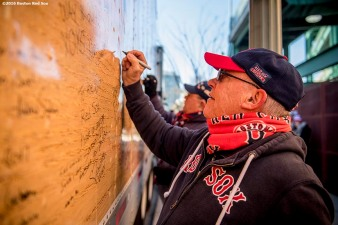 February 6, 2017, Boston, MA: A fan writes a message on the truck during Truck Day at Fenway Park in Boston, Massachusetts Monday, February 6, 2017. (Photo by Billie Weiss/Boston Red Sox)