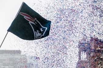 BOSTON, MA - FEBRUARY 07: A flag flies during the New England Patriots Super Bowl victory parade on February 7, 2017 in Boston, Massachusetts. The Patriots defeated the Atlanta Falcons 34-28 in overtime in Super Bowl 51. (Photo by Billie Weiss/Getty Images) *** Local Caption ***