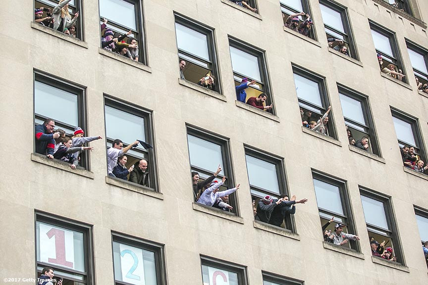 BOSTON, MA - FEBRUARY 07: Fans watch the New England Patriots Super Bowl victory parade on February 7, 2017 in Boston, Massachusetts. The Patriots defeated the Atlanta Falcons 34-28 in overtime in Super Bowl 51. (Photo by Billie Weiss/Getty Images) *** Local Caption ***