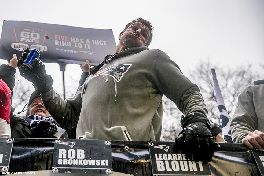 BOSTON, MA - FEBRUARY 07: Rob Gronkowsk of the New England Patriots spikes a beer can during the Super Bowl victory parade on February 7, 2017 in Boston, Massachusetts. The Patriots defeated the Atlanta Falcons 34-28 in overtime in Super Bowl 51. (Photo by Billie Weiss/Getty Images) *** Local Caption *** Rob Gronkowski