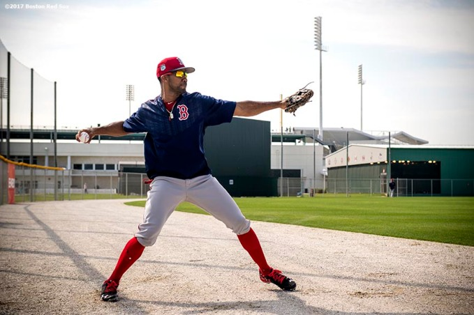 FT. MYERS, FL - FEBRUARY 18: Chris Young #30 of the Boston Red Sox throws from the outfield during a team workout on February 18, 2017 at Fenway South in Fort Myers, Florida . (Photo by Billie Weiss/Boston Red Sox/Getty Images) *** Local Caption *** Chris Young