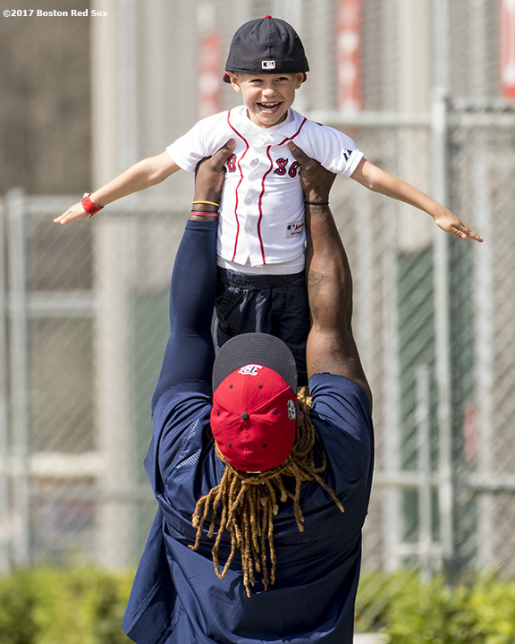 FT. MYERS, FL - FEBRUARY 18: Hanley Ramirez #19 picks up the son of Dustin Pedroia #15 of the Boston Red Sox during a team workout on February 18, 2017 at Fenway South in Fort Myers, Florida . (Photo by Billie Weiss/Boston Red Sox/Getty Images) *** Local Caption *** Dustin Pedroia; Hanley Ramirez