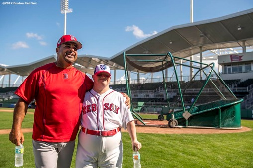 FT. MYERS, FL - FEBRUARY 19: Boston Red Sox assistant hitting coach Victor Rodriguez walks off the field with a participant during a CVS Clinic on February 19, 2017 at Fenway South in Fort Myers, Florida . (Photo by Billie Weiss/Boston Red Sox/Getty Images) *** Local Caption ***