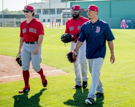 FT. MYERS, FL - FEBRUARY 20: Andrew Benintendi #16, Jackie Bradley Jr. #19, and Mookie Betts #50 of the Boston Red Sox react during a team workout on February 20, 2017 at Fenway South in Fort Myers, Florida . (Photo by Billie Weiss/Boston Red Sox/Getty Images) *** Local Caption *** Andrew Benintendi; Jackie Bradley Jr.; Mookie Betts