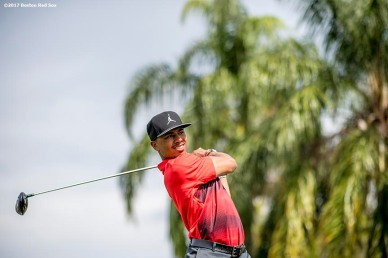 FT. MYERS, FL - FEBRUARY 21: Mookie Betts #50 of the Boston Red Sox follows through on a swing during a Golf Tournament on February 21, 2017 at Fenway South in Fort Myers, Florida . (Photo by Billie Weiss/Boston Red Sox/Getty Images) *** Local Caption *** Mookie Betts