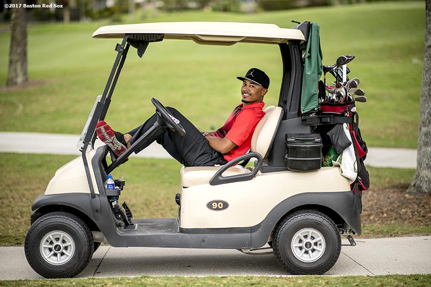 FT. MYERS, FL - FEBRUARY 21: Mookie Betts #50 of the Boston Red Sox poses for a photograph in a golf cart during a Golf Tournament on February 21, 2017 at Fenway South in Fort Myers, Florida . (Photo by Billie Weiss/Boston Red Sox/Getty Images) *** Local Caption *** Mookie Betts