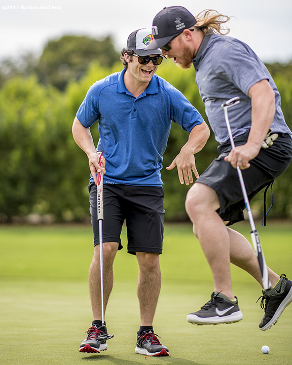 FT. MYERS, FL - FEBRUARY 21: Boston Red Sox outfielder Andrew Benintendi reacts with pitcher Robbie Ross Jr. after sinking a putt during a Golf Tournament on February 21, 2017 at Fenway South in Fort Myers, Florida . (Photo by Billie Weiss/Boston Red Sox/Getty Images) *** Local Caption ***