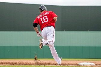 FT. MYERS, FL - FEBRUARY 23: Mitch Moreland #18 of the Boston Red Sox rounds first base after hitting a three run home run during the third inning of a game against Northeastern University on February 23, 2017 at Fenway South in Fort Myers, Florida . (Photo by Billie Weiss/Boston Red Sox/Getty Images) *** Local Caption *** Mitch Moreland