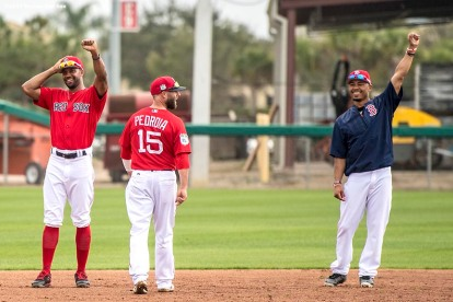 FT. MYERS, FL - FEBRUARY 24: Chris Young #30 and Mookie Betts #50 of the Boston Red Sox react before a game against the New York Mets on February 24, 2017 at Fenway South in Fort Myers, Florida . (Photo by Billie Weiss/Boston Red Sox/Getty Images) *** Local Caption *** Chris Young; Mookie Betts