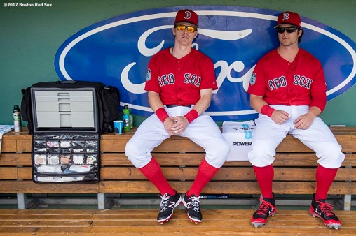 FT. MYERS, FL - FEBRUARY 24: Brock Holt #12 and Andrew Benintendi #16 of the Boston Red Sox sit in the dugout before a game against the New York Mets on February 24, 2017 at Fenway South in Fort Myers, Florida . (Photo by Billie Weiss/Boston Red Sox/Getty Images) *** Local Caption *** Brock Holt; Andrew Benintendi