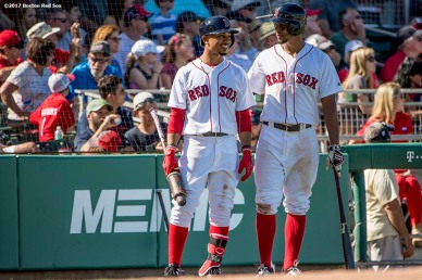 FT. MYERS, FL - FEBRUARY 25: Mookie Betts #50 and Xander Bogaerts #2 of the Boston Red Sox talk during the fourth inning of a spring training game against the Minnesota Twins on February 25, 2017 at Fenway South in Fort Myers, Florida . (Photo by Billie Weiss/Boston Red Sox/Getty Images) *** Local Caption *** Mookie Betts; Xander Bogaerts